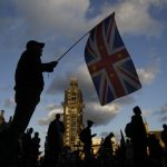 An anti-Brexit protester with a composite Union and EU flag is seen on Parliament Square outside the Houses of Parliament in central London on September 4, 2019. - British lawmakers inflicted a fresh defeat on Prime Minister Boris Johnson's Brexit strategy on Tuesday, approving in principle a law that could stop him taking Britain out of the European Union without a deal next month. (Photo by Tolga AKMEN / AFP)        (Photo credit should read TOLGA AKMEN/AFP/Getty Images)